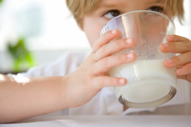 Young Boy Drinking Milk